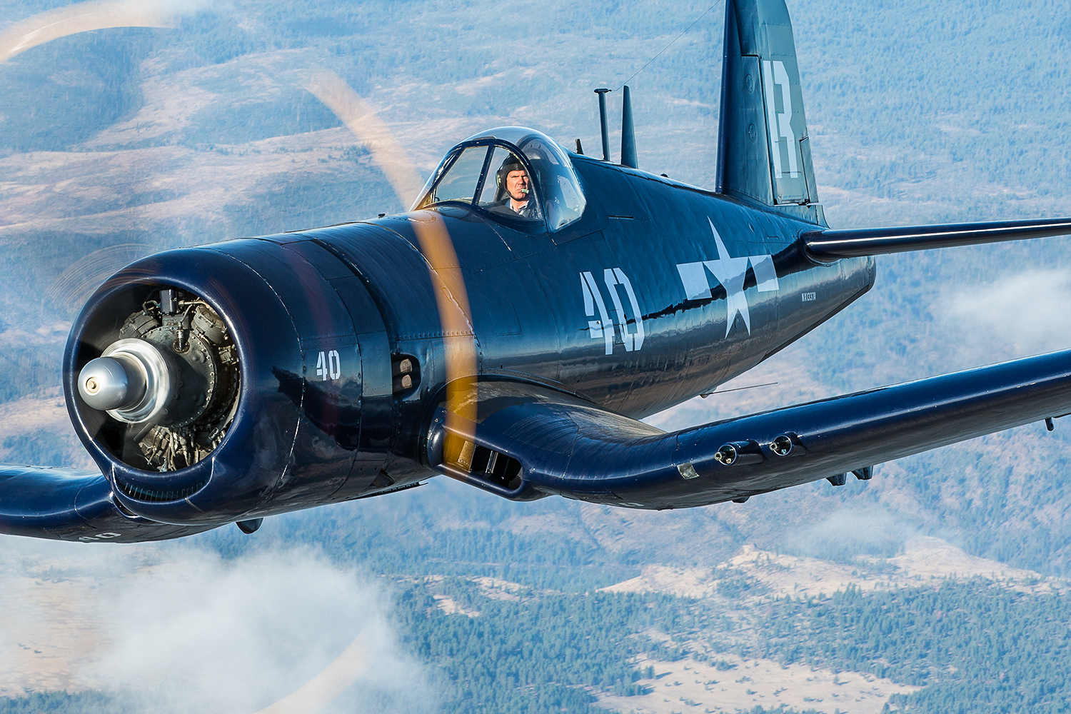 The Erickson Aircraft Collection's F4U-7 Corsair over the beautiful Pacific Northwest during the Air2Air Experience in 2014. (photo by Matt Booty)