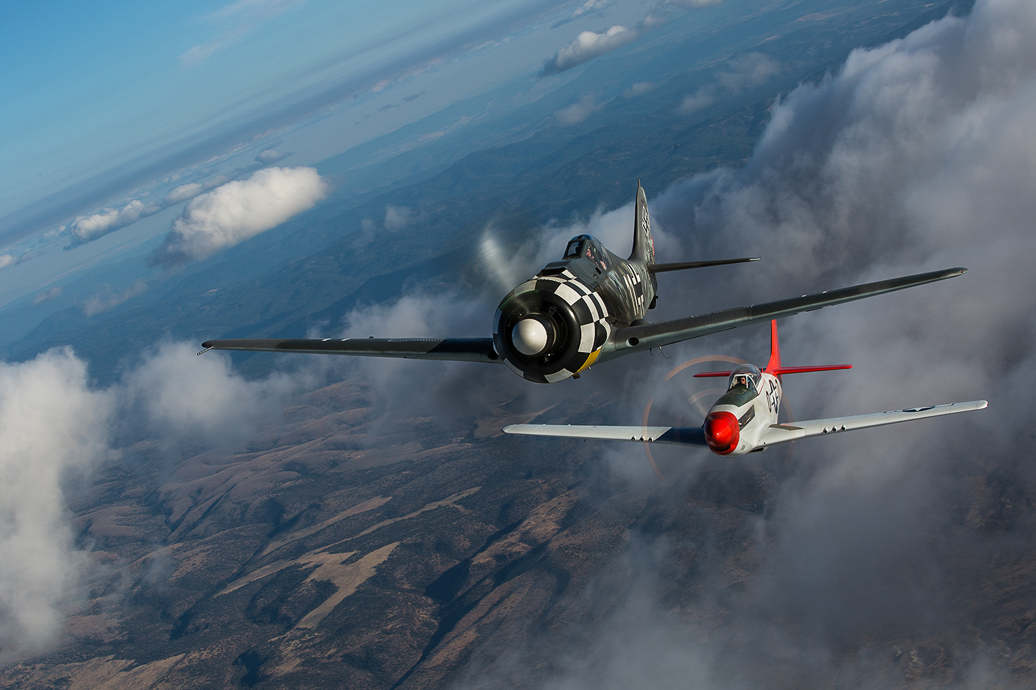 The Erickson Aircraft Collection's Flugwerk FW-190A8/N and the Heritage Flight Museum's P-51D Mustang formed up during the Air2Air Experience in 2014. (photo by Matt Booty)
