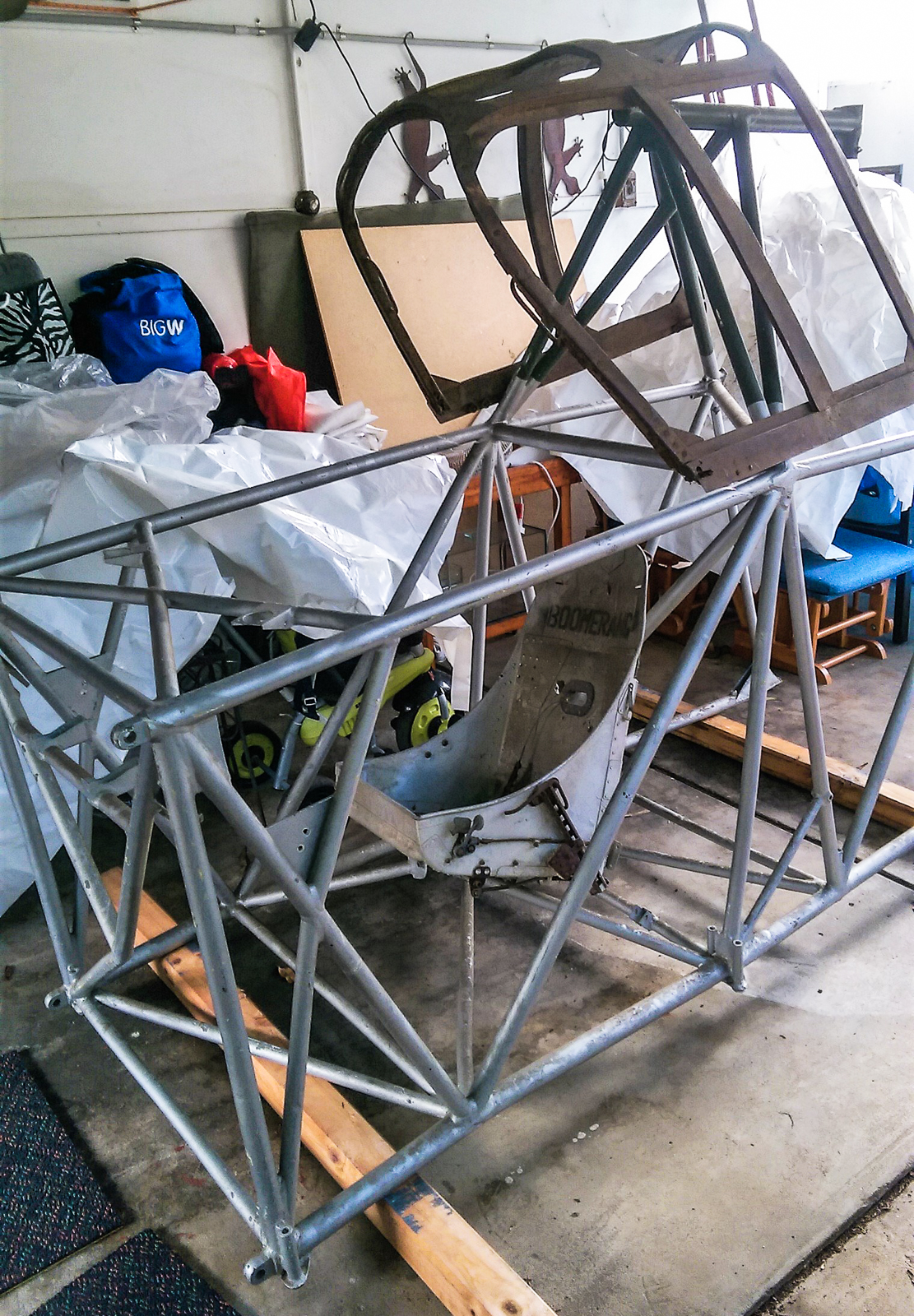 The statically restored fuselage frame for A46-3 sitting in Rick Anderson's garage. Note the unrestored cockpit canopy and pilot's seat in the image. (photo by Rick Anderson)