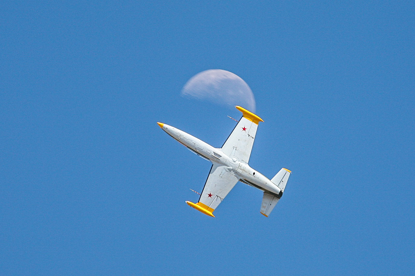 A stunning shot of the L-39 passing the moon. (photo by Phil Buckley)