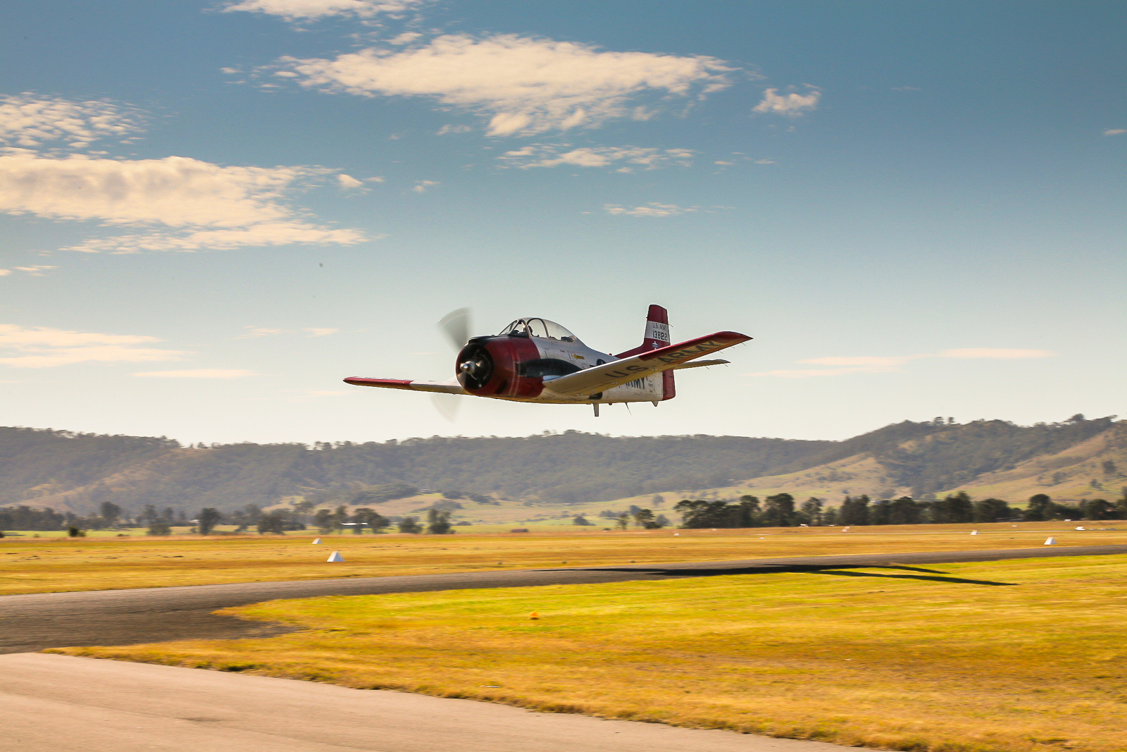 Paul Bennet Airshows' T-28 Trojan on takeoff. (photo by Phil Buckley)