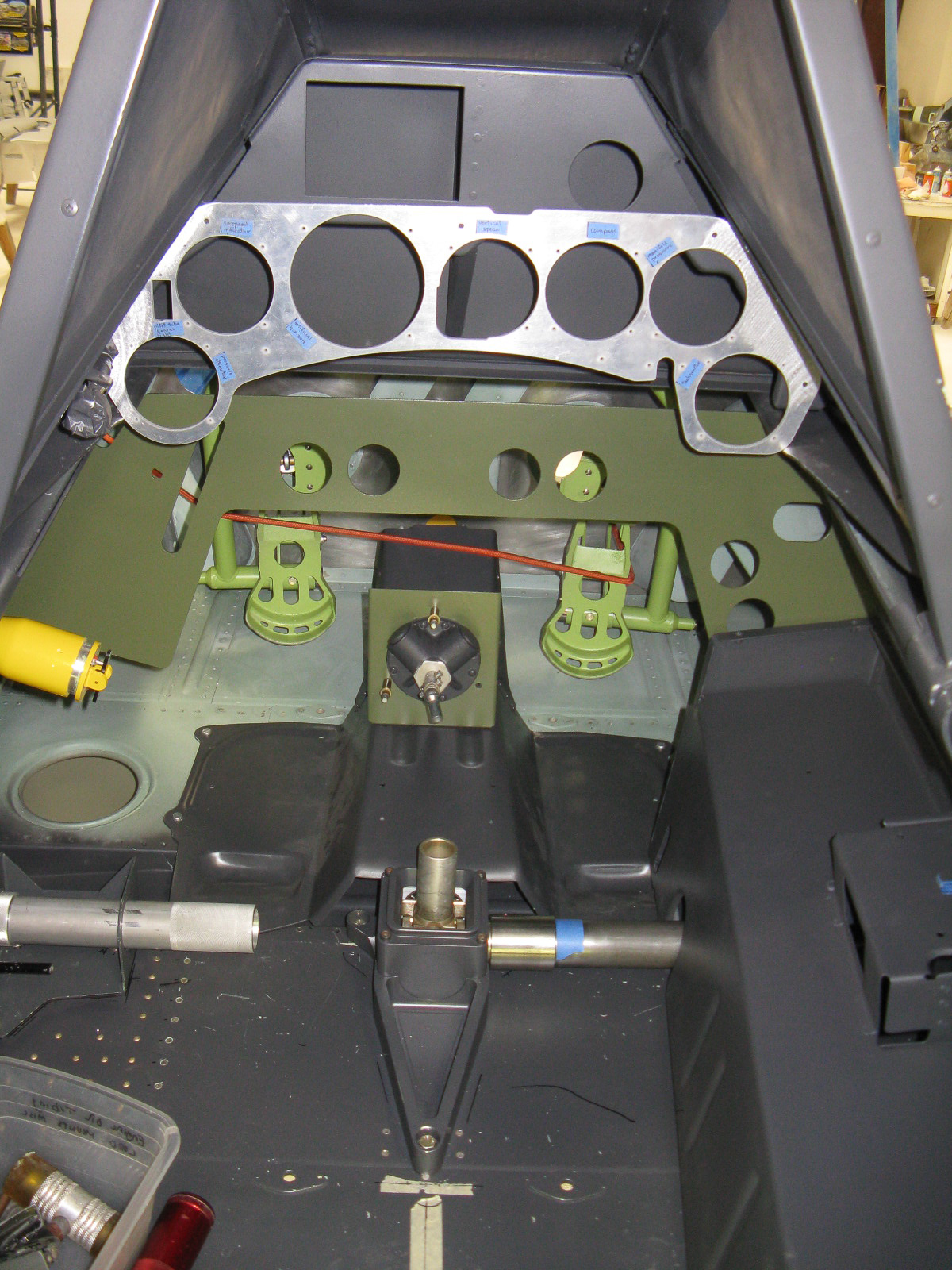 Test-fitting the custom-made instrument panel in the FW-190. (photo via GossHawk Unlimited)