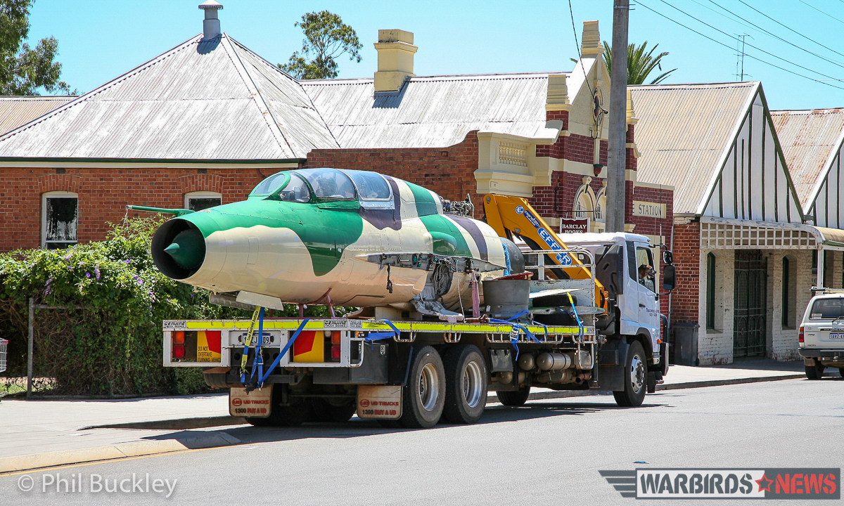 The former Egyptian Air Force MiG-21U Mongul-B on the road to its new home at White Gum Farm airport. (image by Phil Buckley)