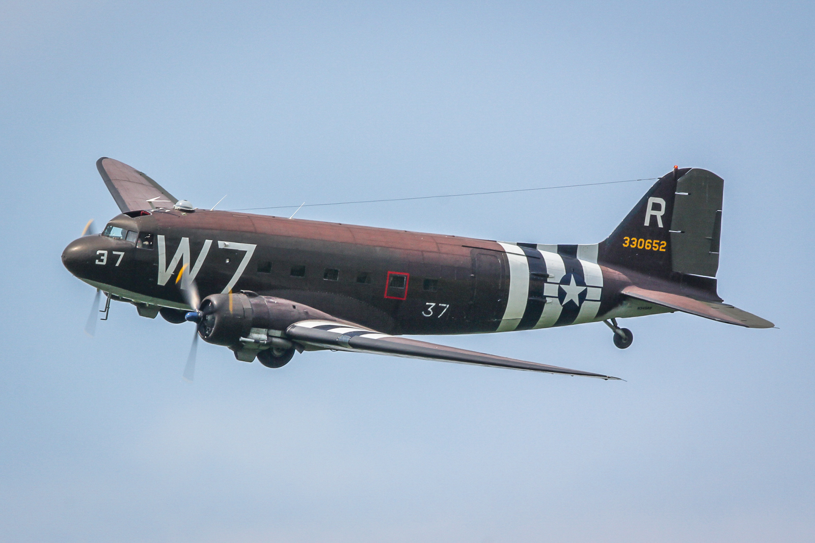 The National Warplane Museum's C-47 'Whiskey 7' flown by Chris Polhemus and John Lindsay. (photo by Tom Pawlesh)
