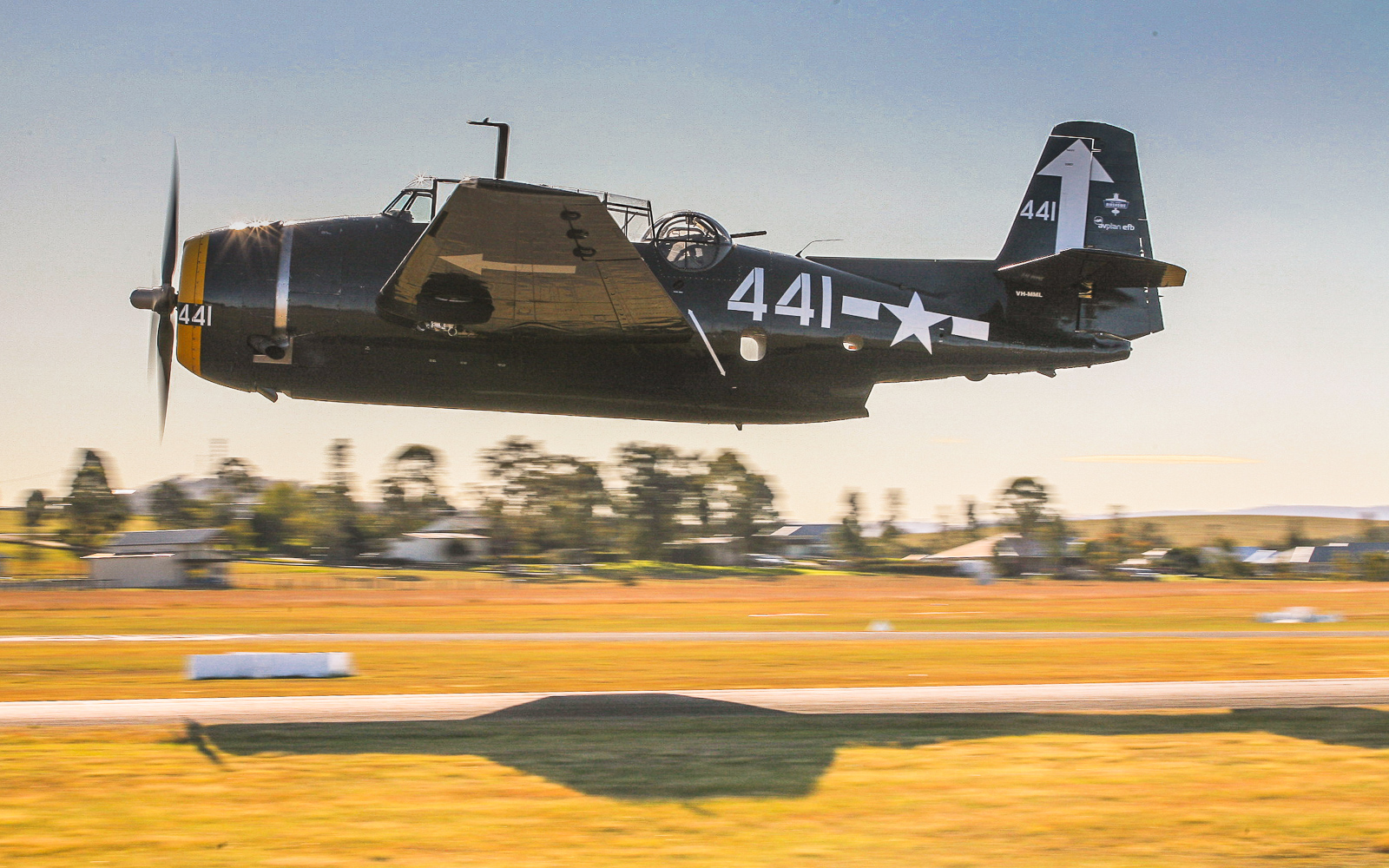 Paul Bennet's marvelous TBM-3 Avenger roars into the air at the Maitland Air Show. (photo by Phil Buckley)
