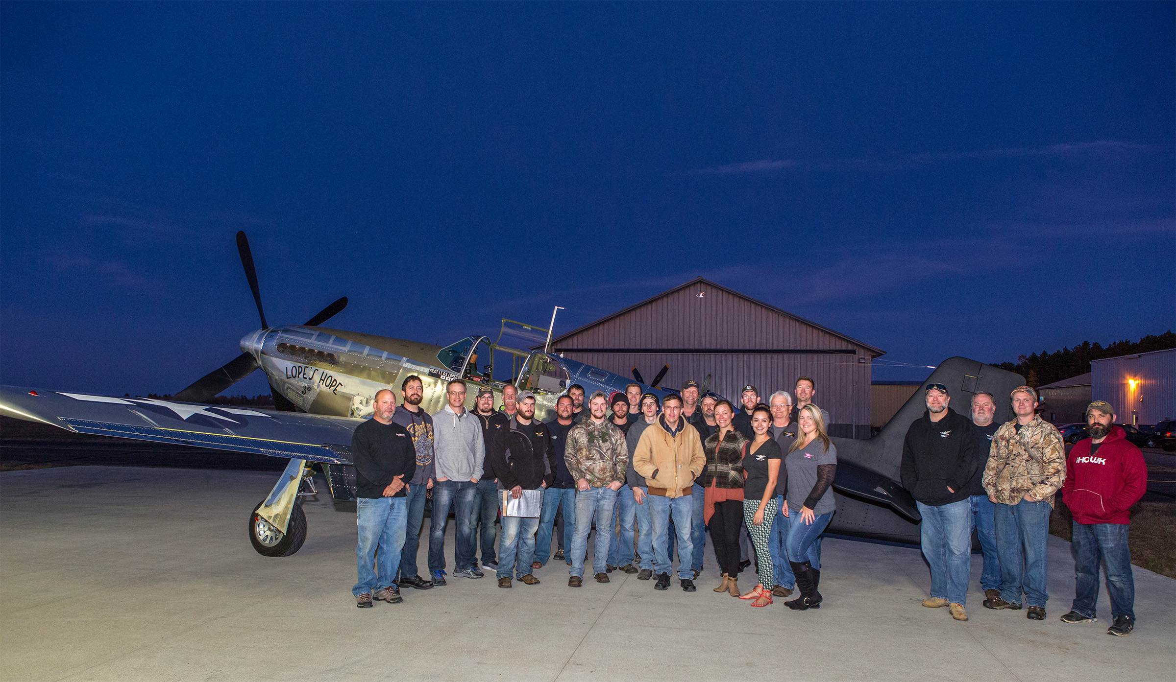A very pleased AirCorps Aviation crew poses in front of Lope's Hope 3rd after a squawk-free test flight. (photo by John LaTourelle via AirCorps Aviation)