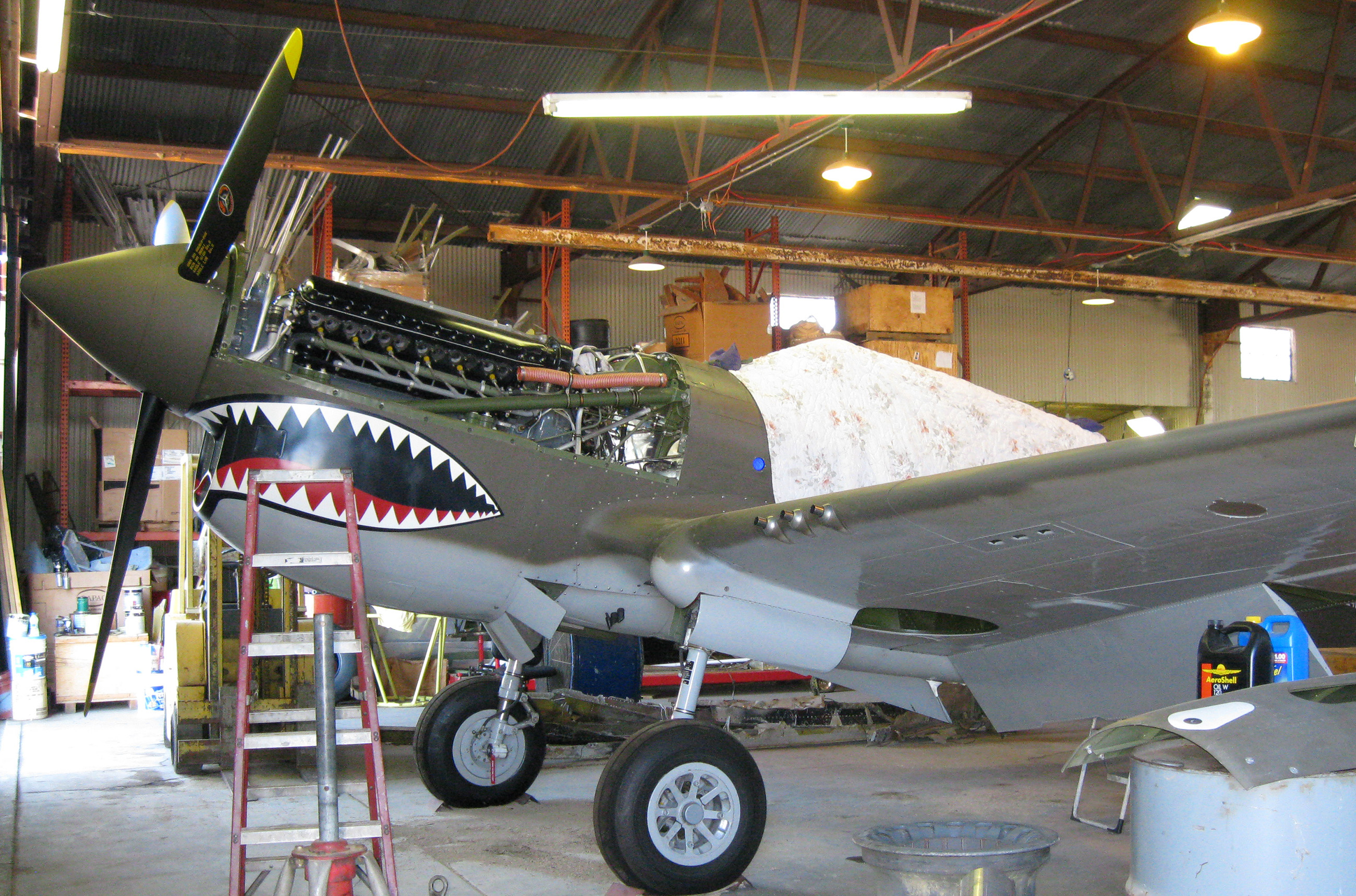 Don Brooks P-40 Warhawks while it was still under restoration with Tom Reilly in Douglas, Georgia. (photo via Matt Jolley)