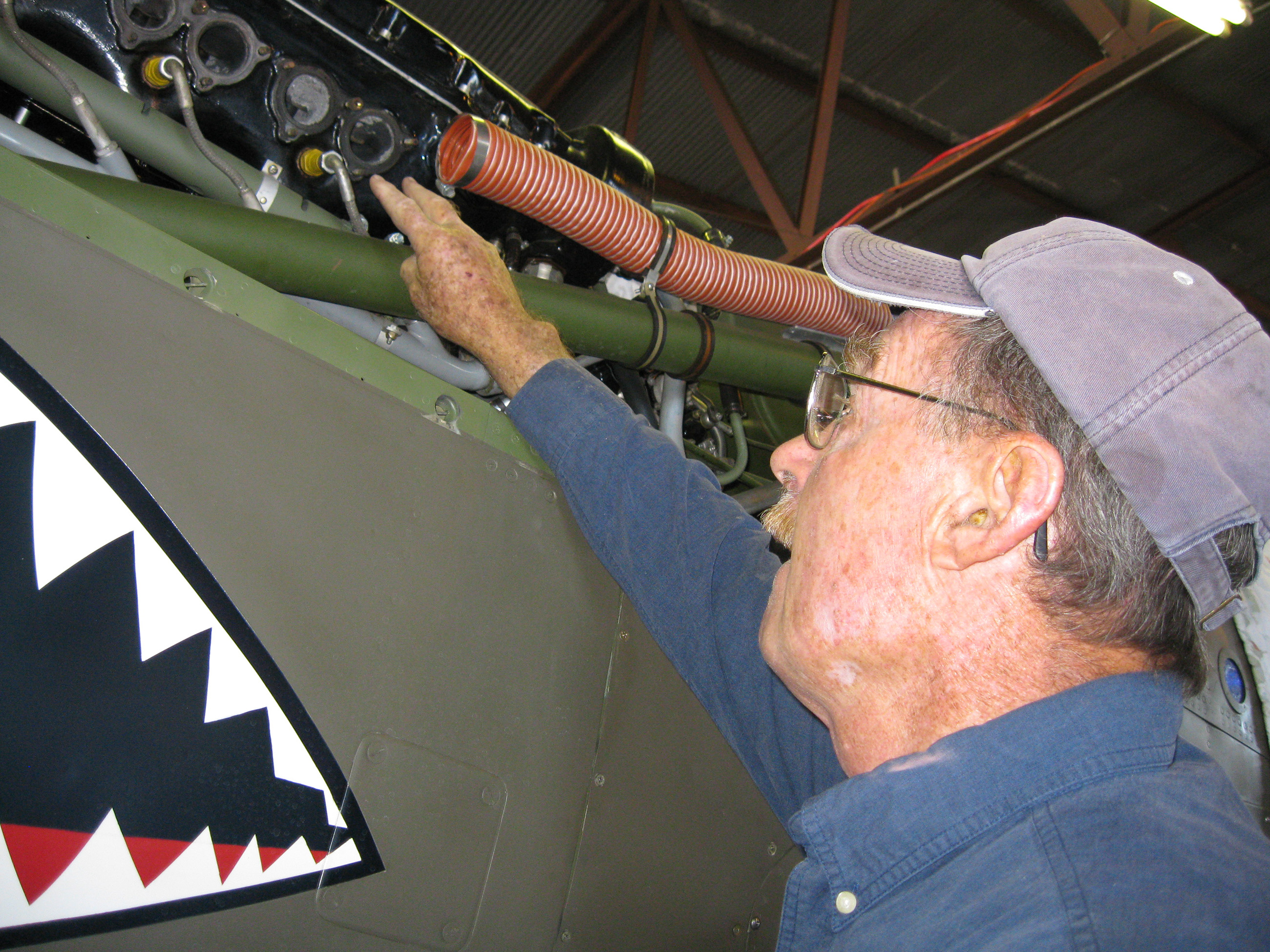 Tom Reilly working on the Allison V-1710 engine in Don Brooks P-40 Warhawk back in 2009. (photo via Matt Jolley)
