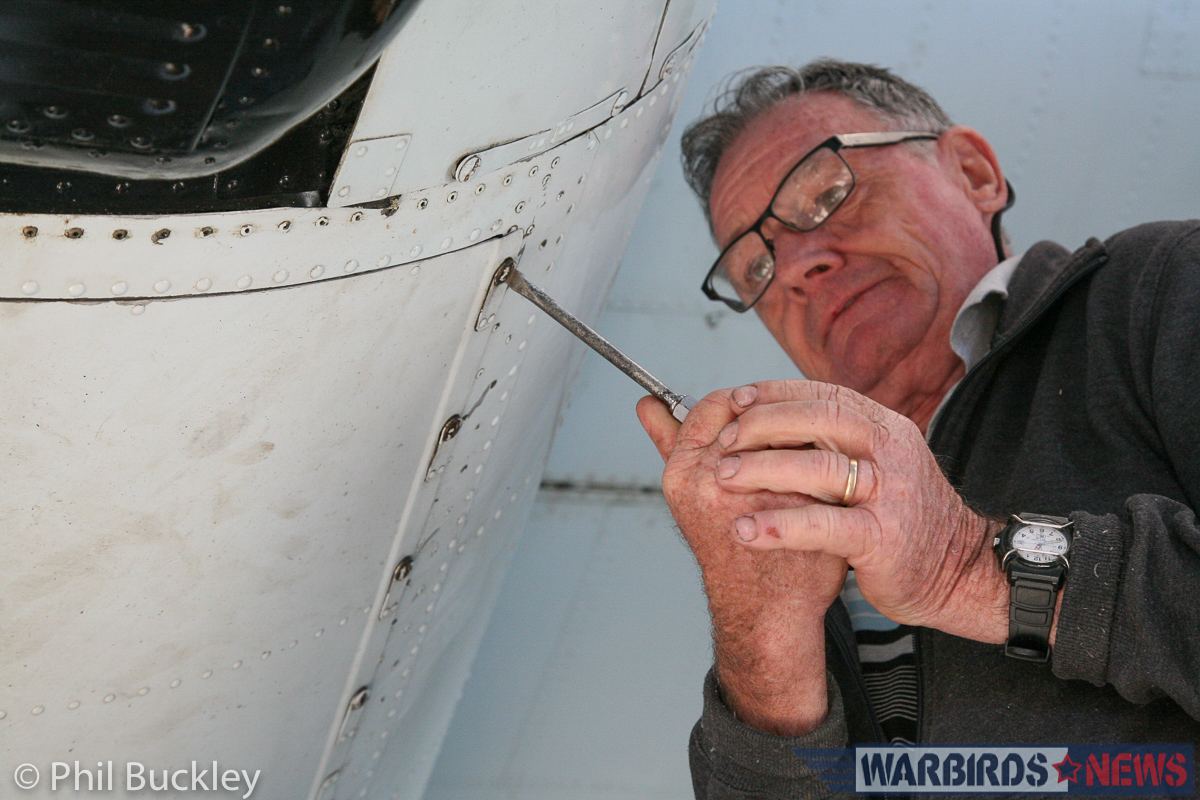 Chief Engineer Johnny Land buttoning up the engine nacelle access panels. (photo by Phil Buckley)