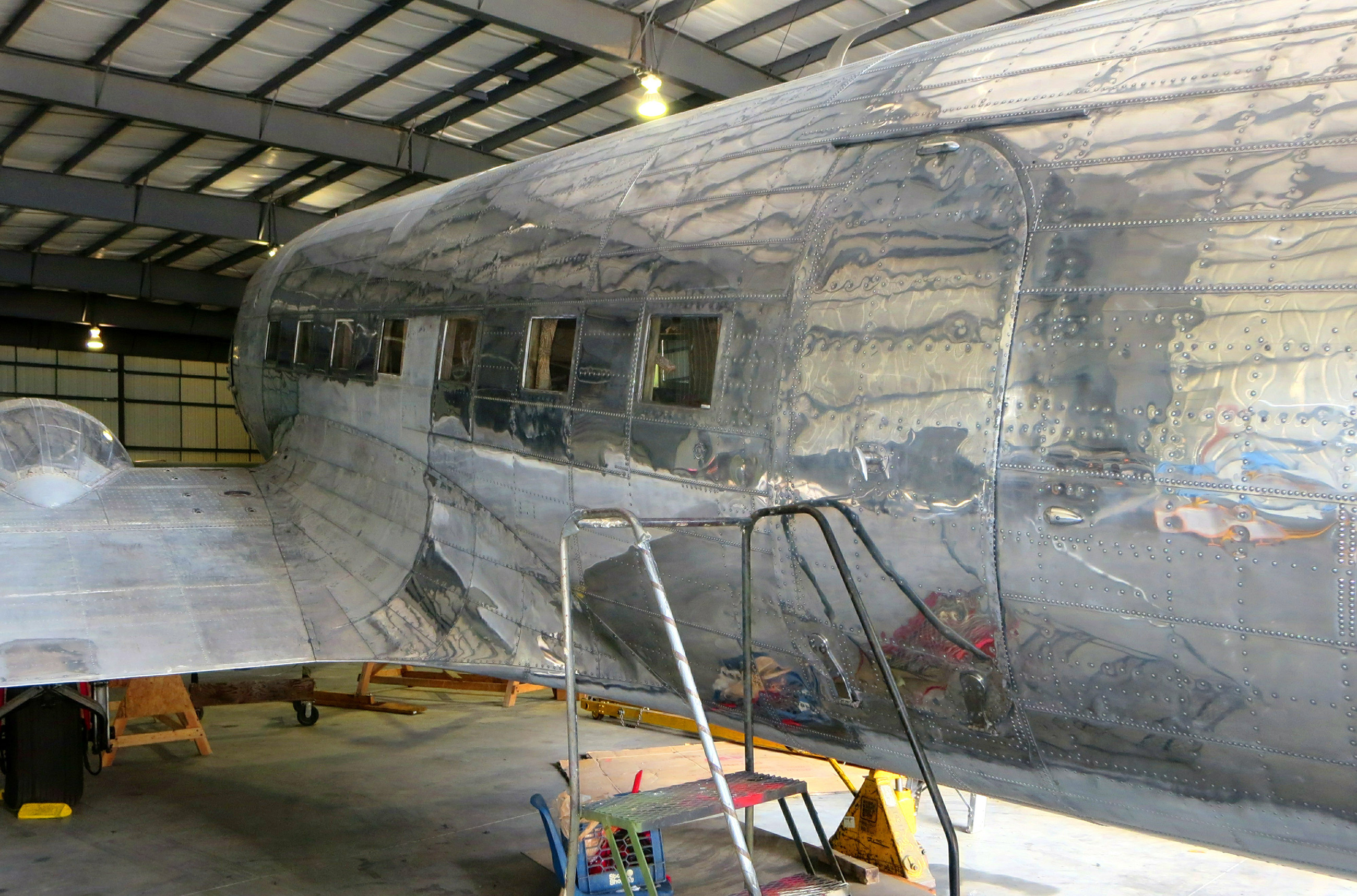 The fuselage is now well into the polishing process, and it's clear that the end results will be breathtakingly beautiful. (photo via NEAM)