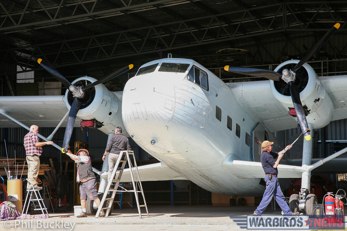 Pulling the props through in the shade, prior to wheeling her out for an engine test. (photo by Phil Buckley)