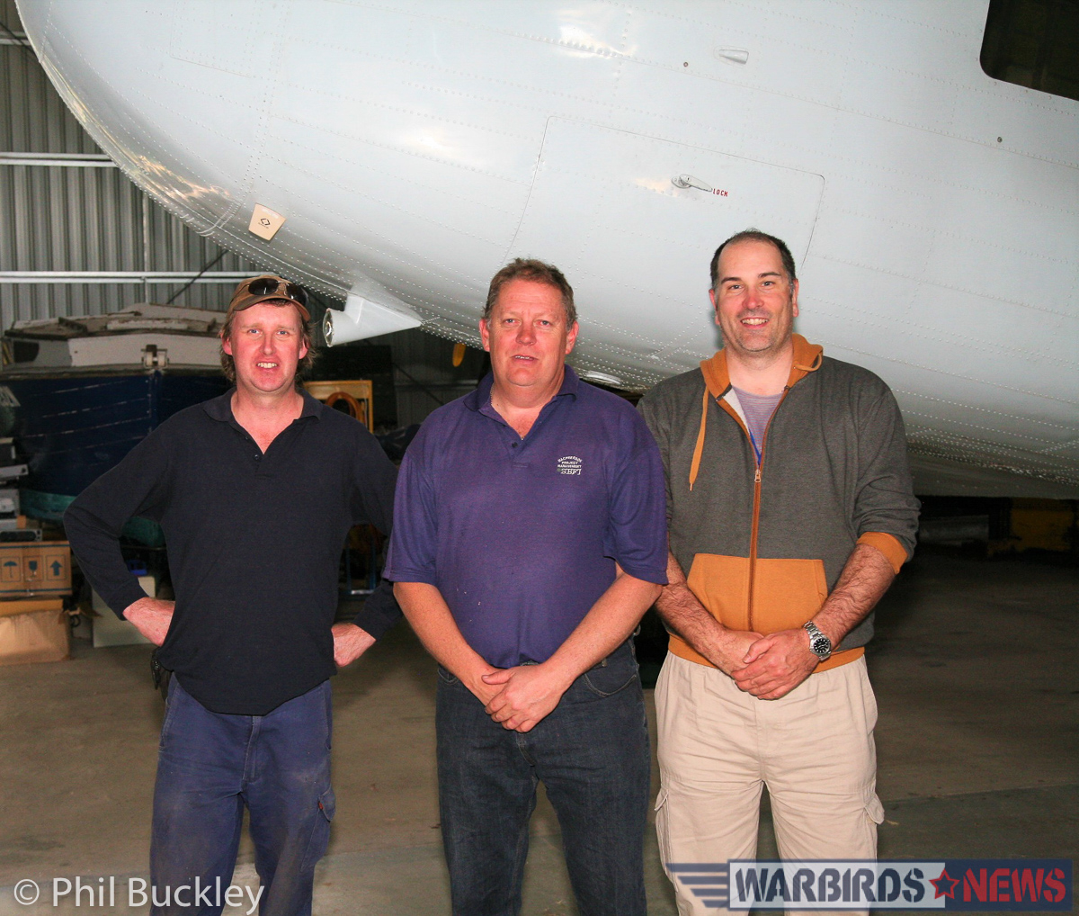 (l-r) Mark Booth, Richard Thompson and Phil Buckley standing under the Twin Pin's nose. (Photo via Phil Buckley)