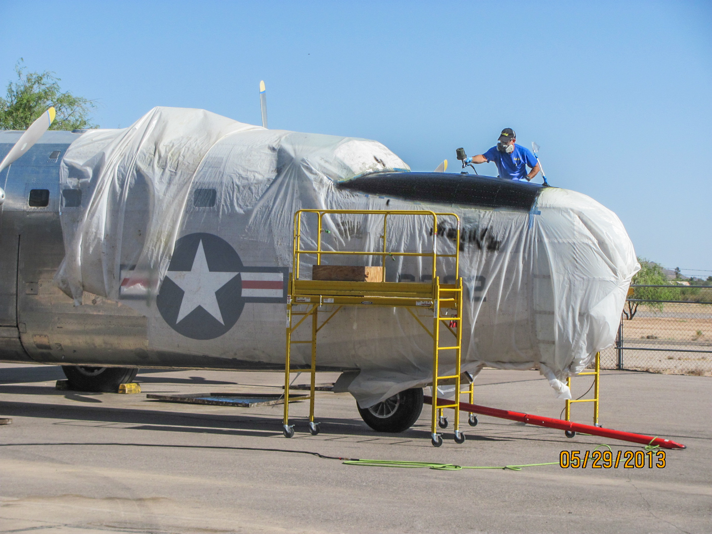 The anti-glare paint going on in front of the cockpit following the paint stripping in 2013. (GossHawk Unlimited photo)