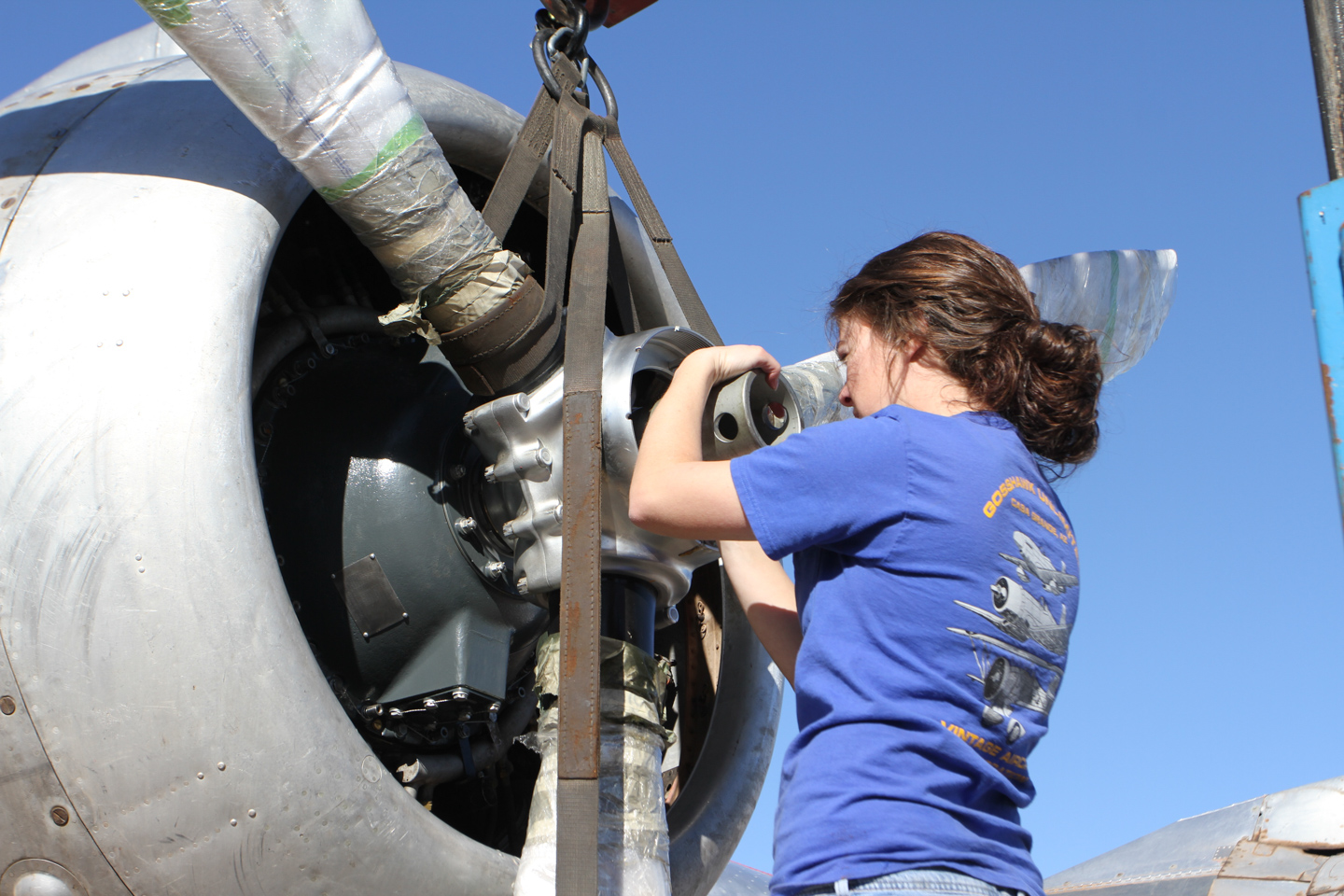 Lindsey Goss working on the #4 prop after a dynamic balance test uncovered an issue. (GossHawk Unlimited photo)