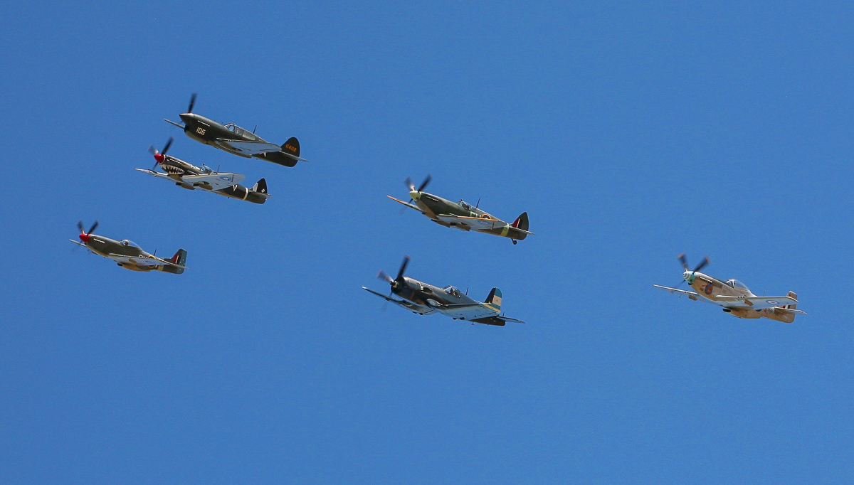 A gaggle of WWII-era fighters in formation was a highlight of Warbirds Downunder. (photo by Phil Buckley)