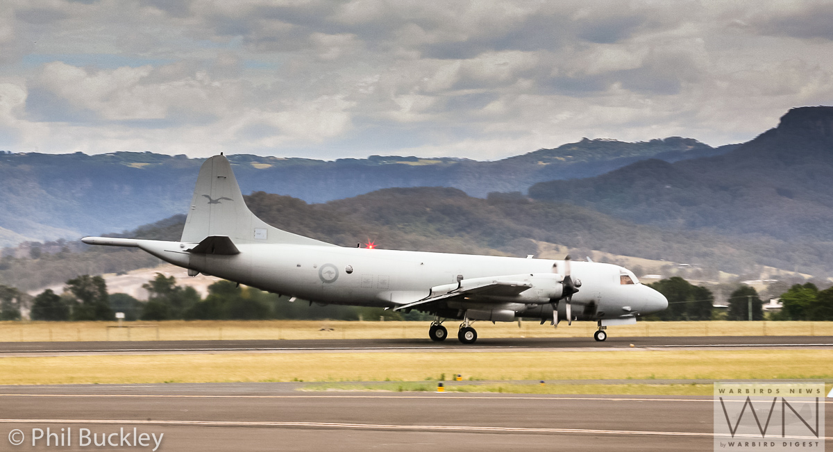 RAAF Orion A9-659 roaring down the runway. (photo by Phil Buckley)