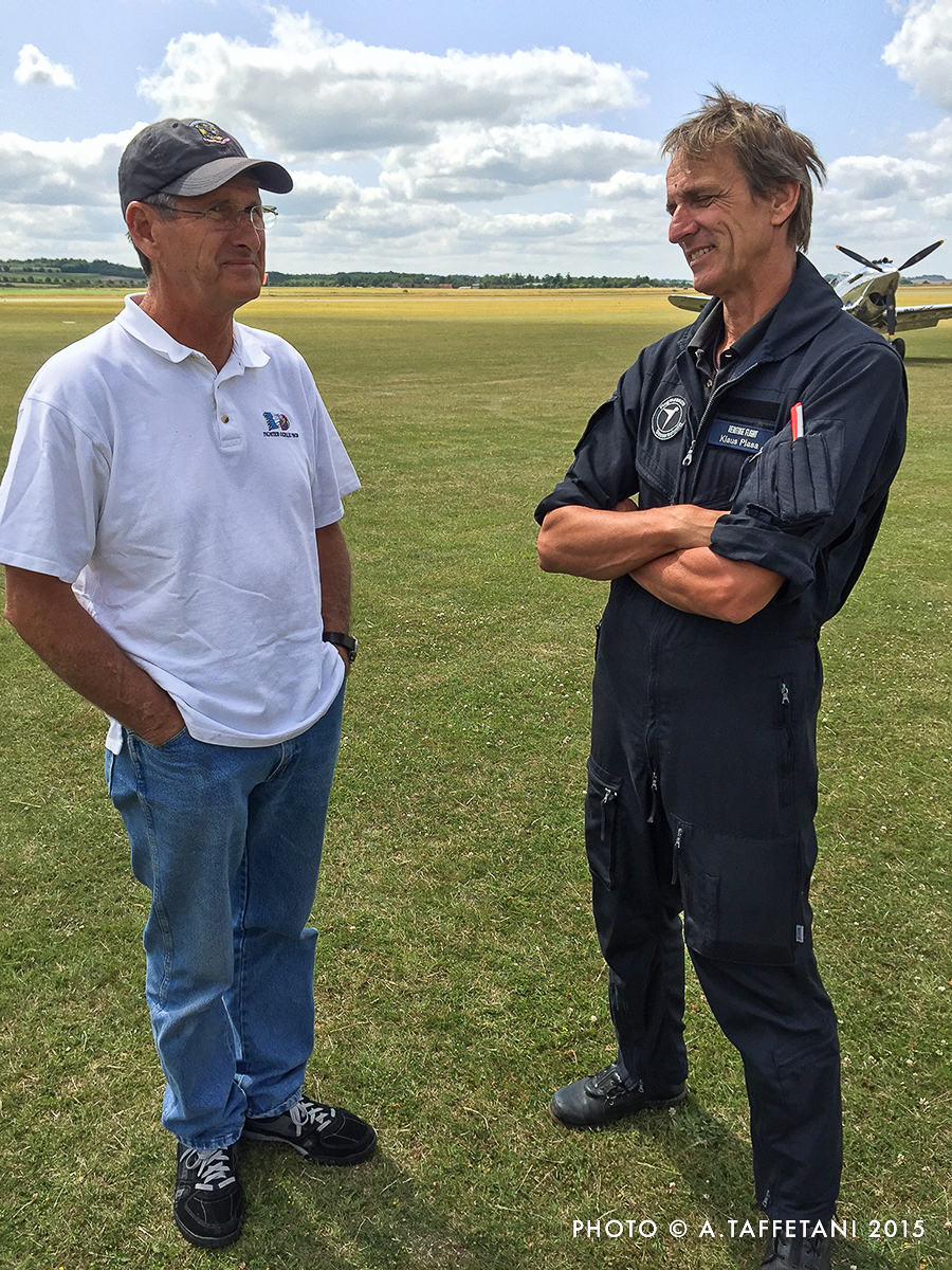 The legendary Steve Hinton (left) and Klaus Plasa talking it up before Flying Legends. (photo by Alessandro Taffetani)
