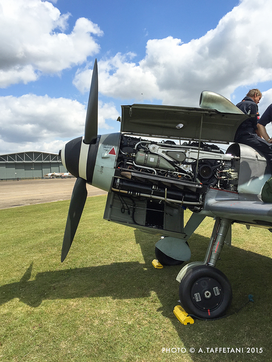 EADS Bf 109 with it's engine cowlings popped open a couple of days before Flying Legends. (photo by Alessandro Taffetani)