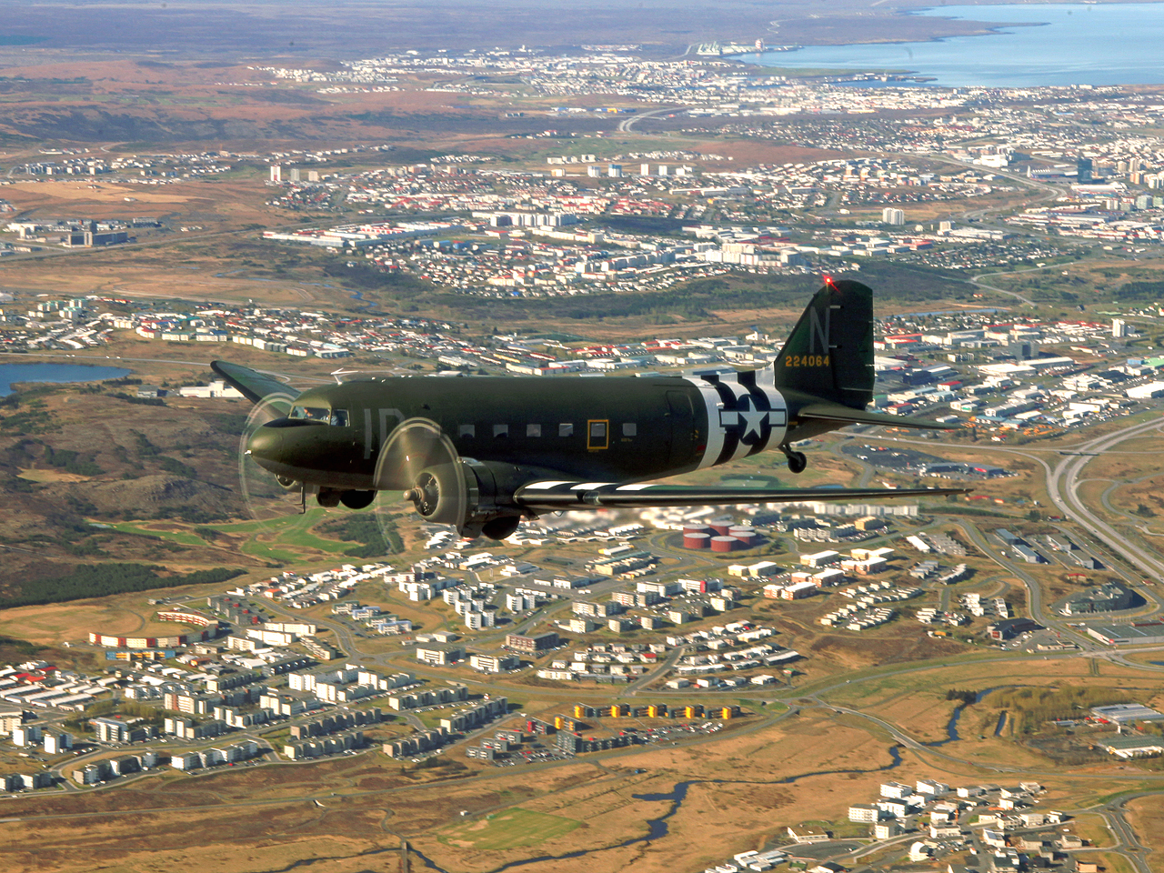 """Union Jack Dak"" over Reykjavik, Iceland during her journey out to France. (photo by Baldur Sveinsson)"