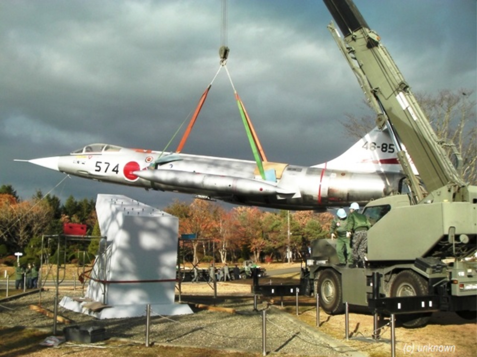 F-104J 46-8574 being lowered onto its plinth at in Hokkaido, Japan following its recent restoration. (photo JASDF Chitose Air Base via International F-104 Association)