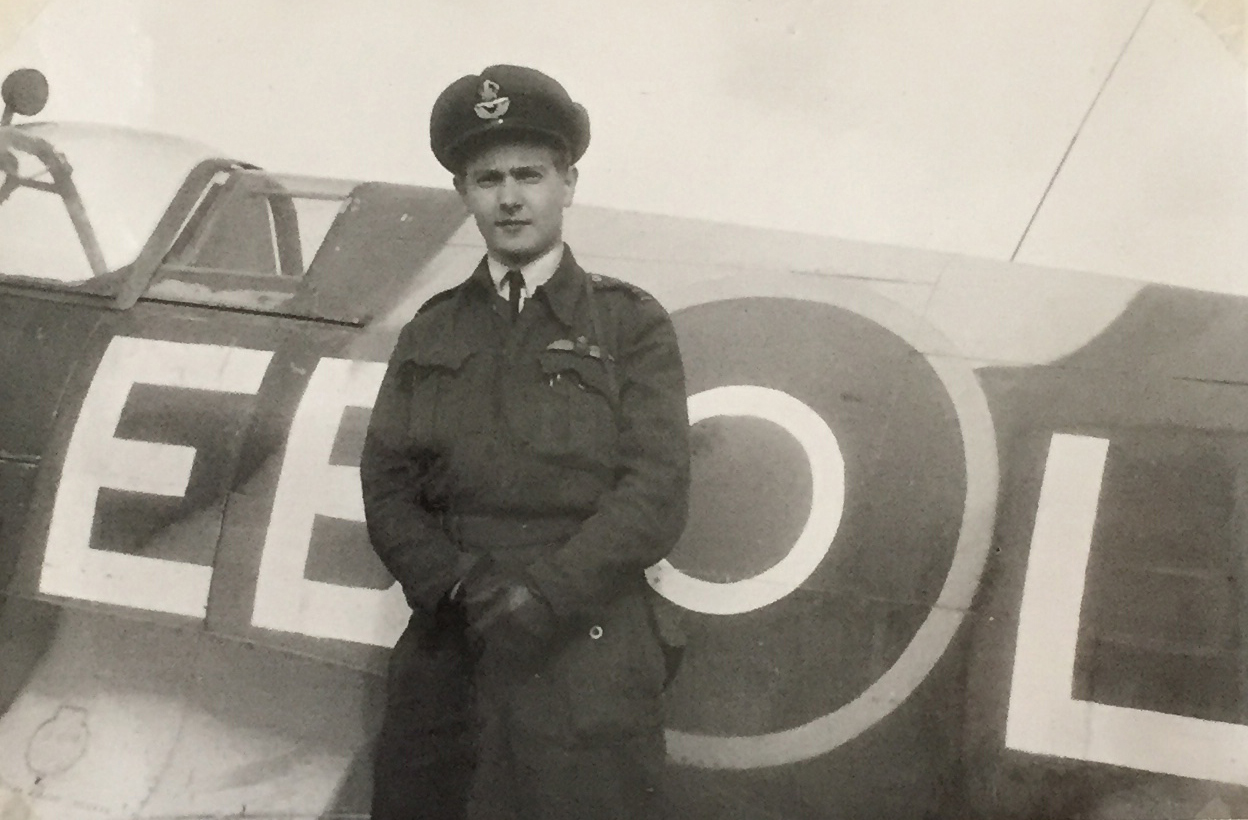 F/L John Wilkinson stands next to his Spitfire Mk.14 circa 1945, Belgium