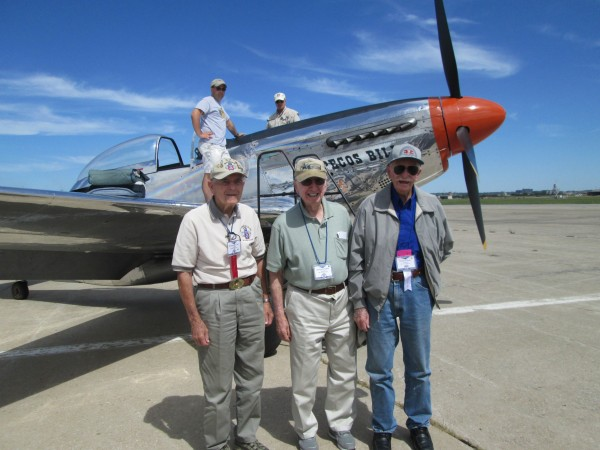 """Pecos Bill"" with three happy customers in Kansas: WWII veterans (l-r) Raymond Fary, Clifford Kantz and Lynus Ryan. (photo by Jen Charlton)"