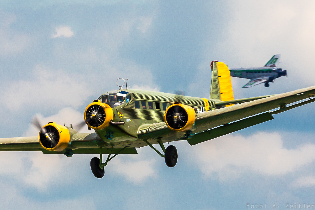 A pair of Junkers Ju-52s in the sky together.