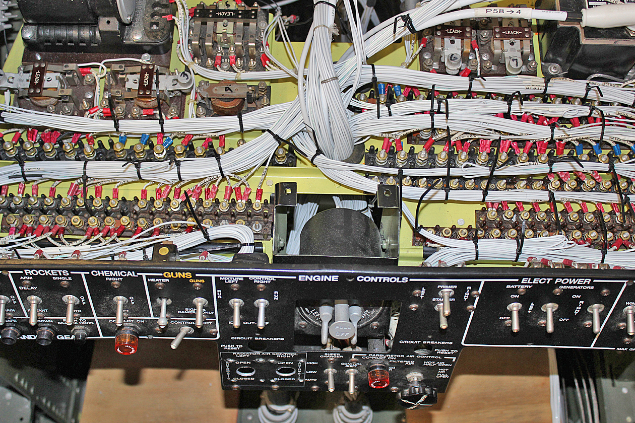 Left Hand pilot's side electrical shelf partially completed with the temporary tie wraps prior to lacing cord. (photo via Tom Reilly)