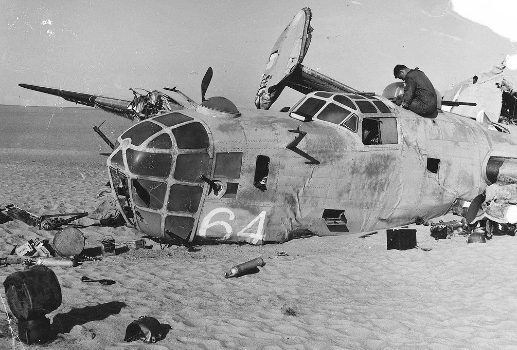 Nose view of Consolidated B-24D Lady Be Good crash site. The plane made a surprisingly good pilotless belly landing and skidded 700 yards before breaking in half and stopping. (U.S. Air Force photo)