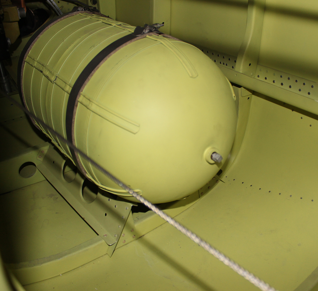 The large oxygen bottle mounted in the lower rear of each fuselage. (photo via Tom Reilly)