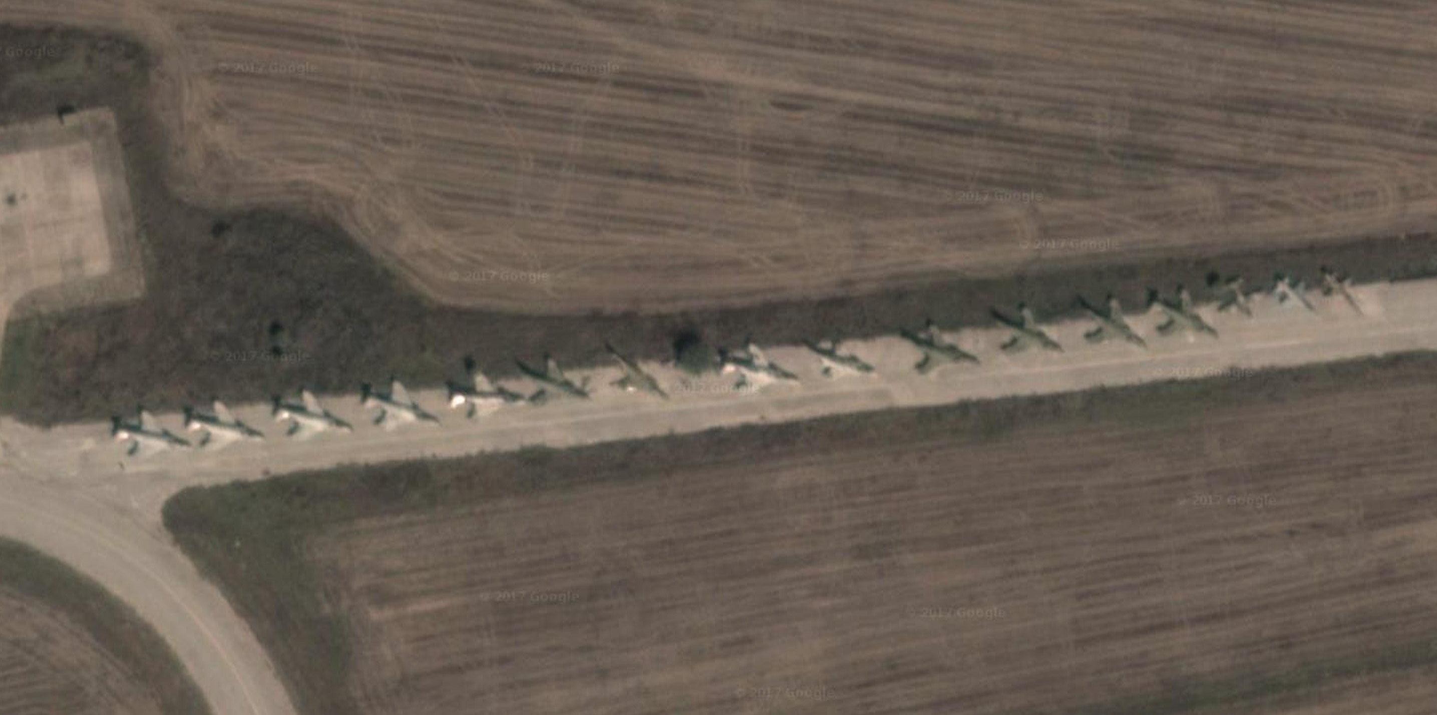 Some of the retired RF-4Es serving as decoys and parts sources at Larissa. (Photo via Googlemaps)
