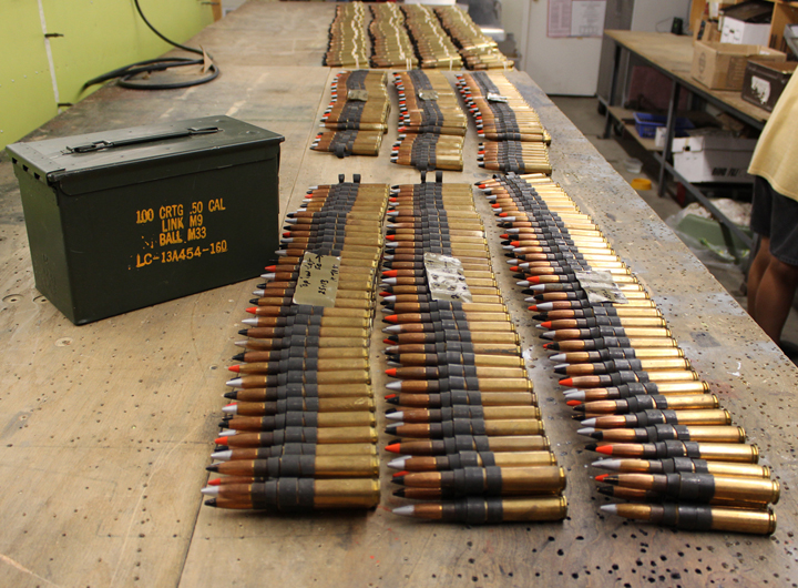 Linked .50 caliber cartridges and ammo box. (photo via Tom Reilly)