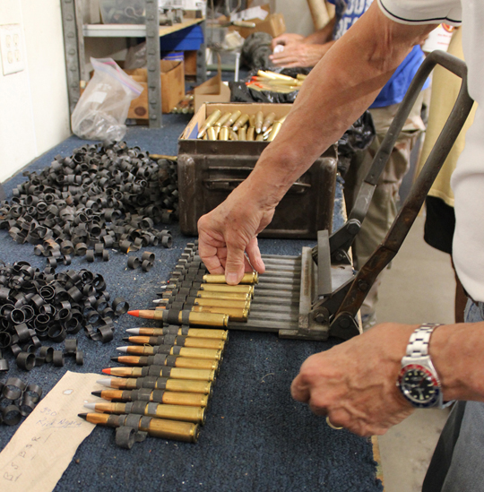 Loading the .50 caliber cartridges into the linker. (photo via Tom Reilly)