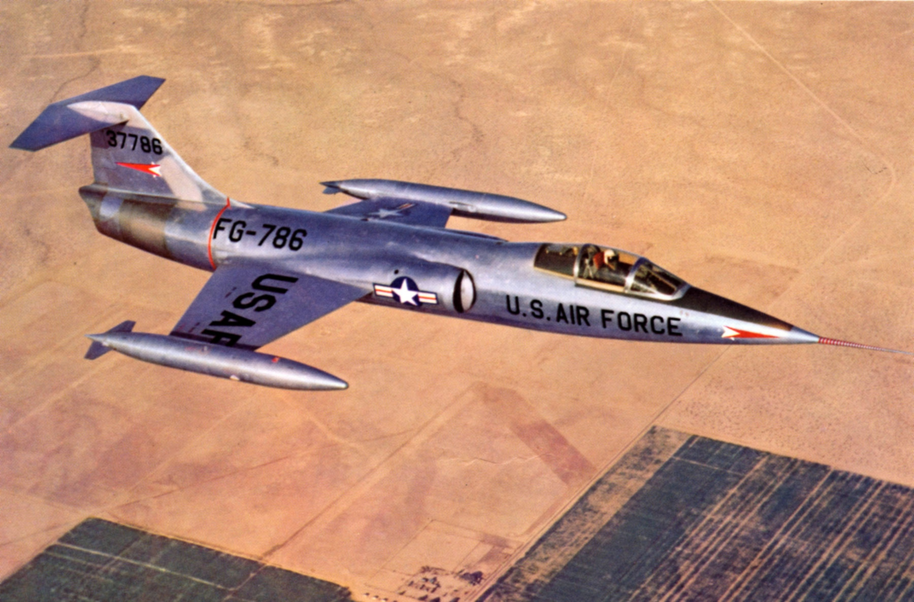 The first XF-104, serial number 53-7786, on a test flight near Edwards AFB. This aircraft crashed in 1957 following flutter problems which ripped the tail from the fuselage. The pilot, Bill Park, ejected safely. (image via Wikipedia)