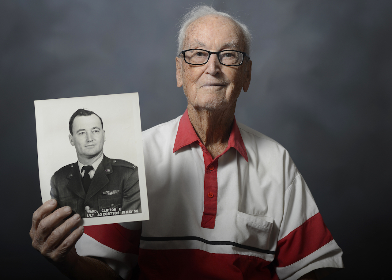Retired Lt. Col. Clifton Ward, World War II and Vietnam combat pilot, shows his official photo taken on May 19, 1955, during a visit to MacDill Air Force Base, Fla., Nov. 5, 2015. During his illustrious flying career, Ward piloted 29 aircraft, was reported missing in action, and earned the Distinguished Flying Cross, the Bronze Star Medal, and an Air Medal for his actions in WWII and Vietnam. (U.S. Air Force photo by Tech. Sgt. Brandon Shapiro/Released)