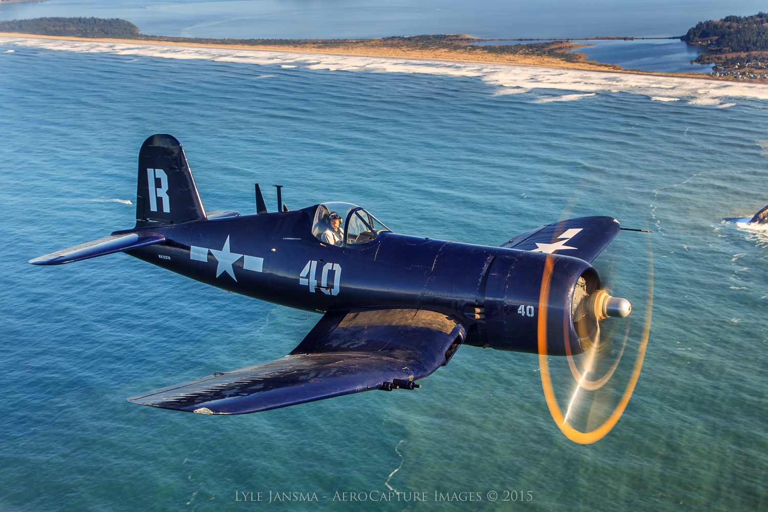 The Erickson Aircraft Collection's F4U-7 Corsair captured by Lyle Jansma over the Pacific coast. (photoAeroCapture Images™ |  Jansma Design LLC)