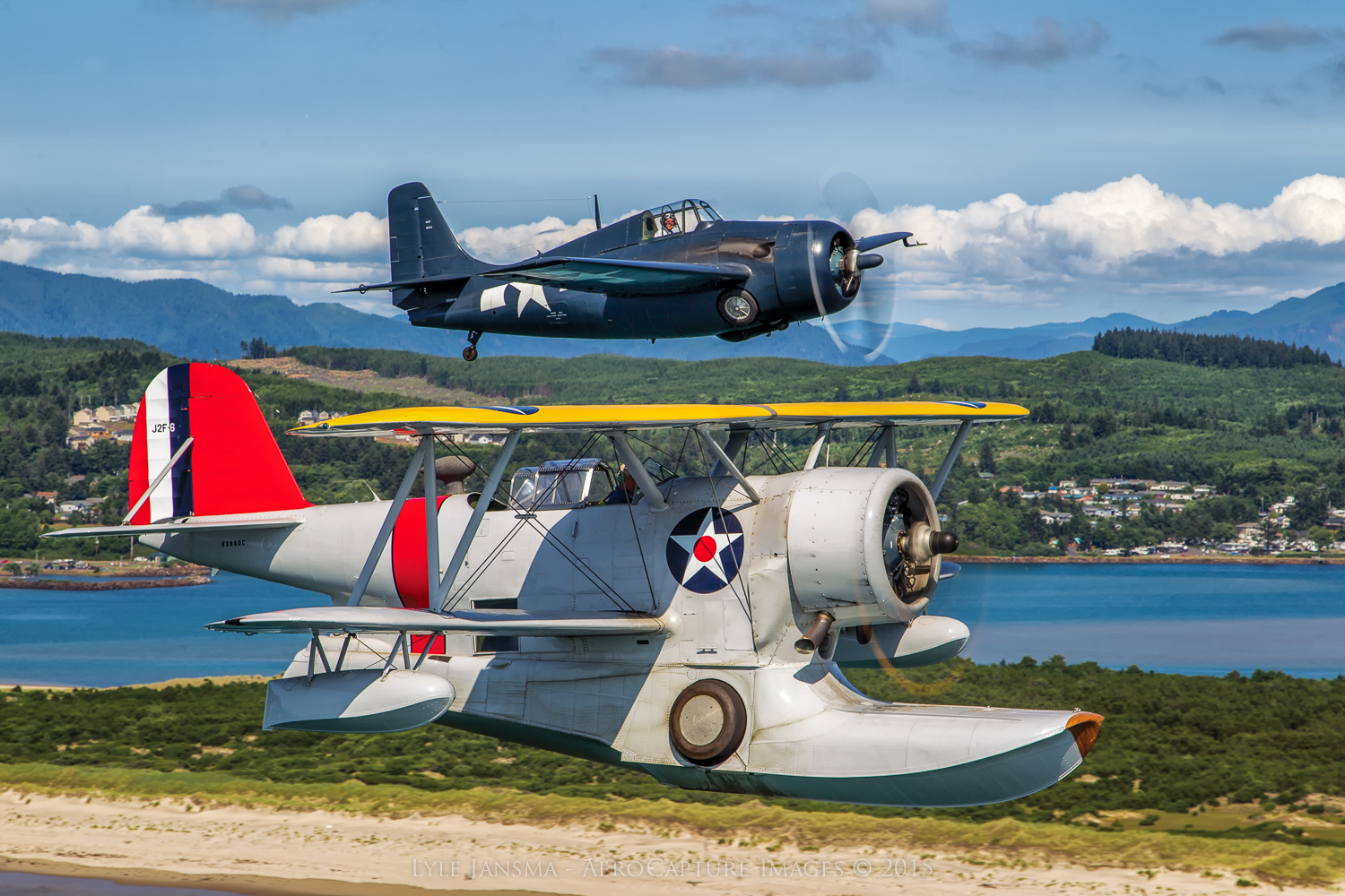 The Erickson Aircraft Collection's Grumman Duck and FM-2 Wildcat captured over the dramatic landscape of Oregon's coastal region. (photo by Lyle Jansma -AeroCapture Images™ |  Jansma Design LLC)
