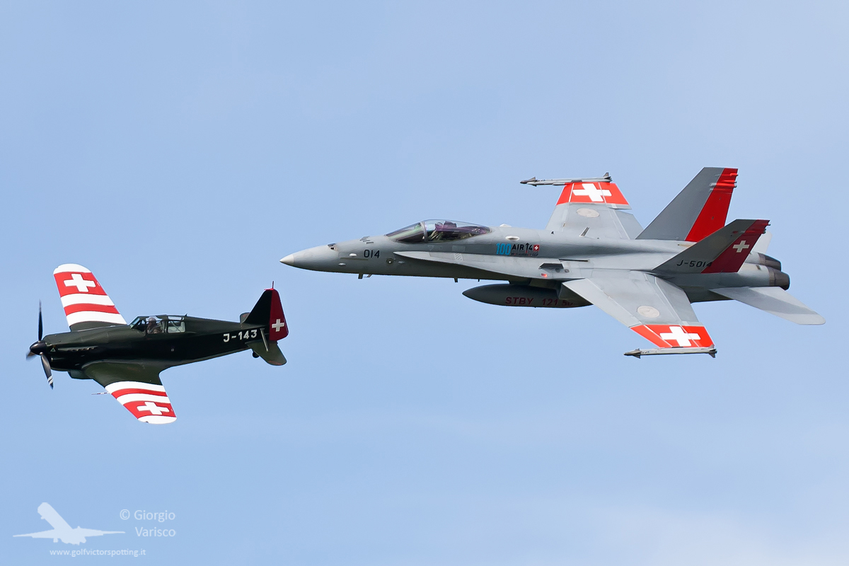 Old and new-ish... the world's only representative of a Morane Saulnier MS.406 in formation with a Swiss F/A-18. (photo by Giorgio Varisco)