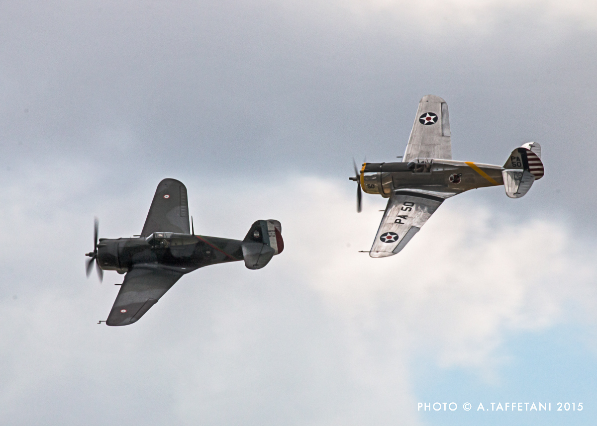 TFC's Hawk 75 leading the P--36 in a tail chase and demonstrating the nearly identical lines of the two unique flyers. (photo by Alessandro Taffetani)