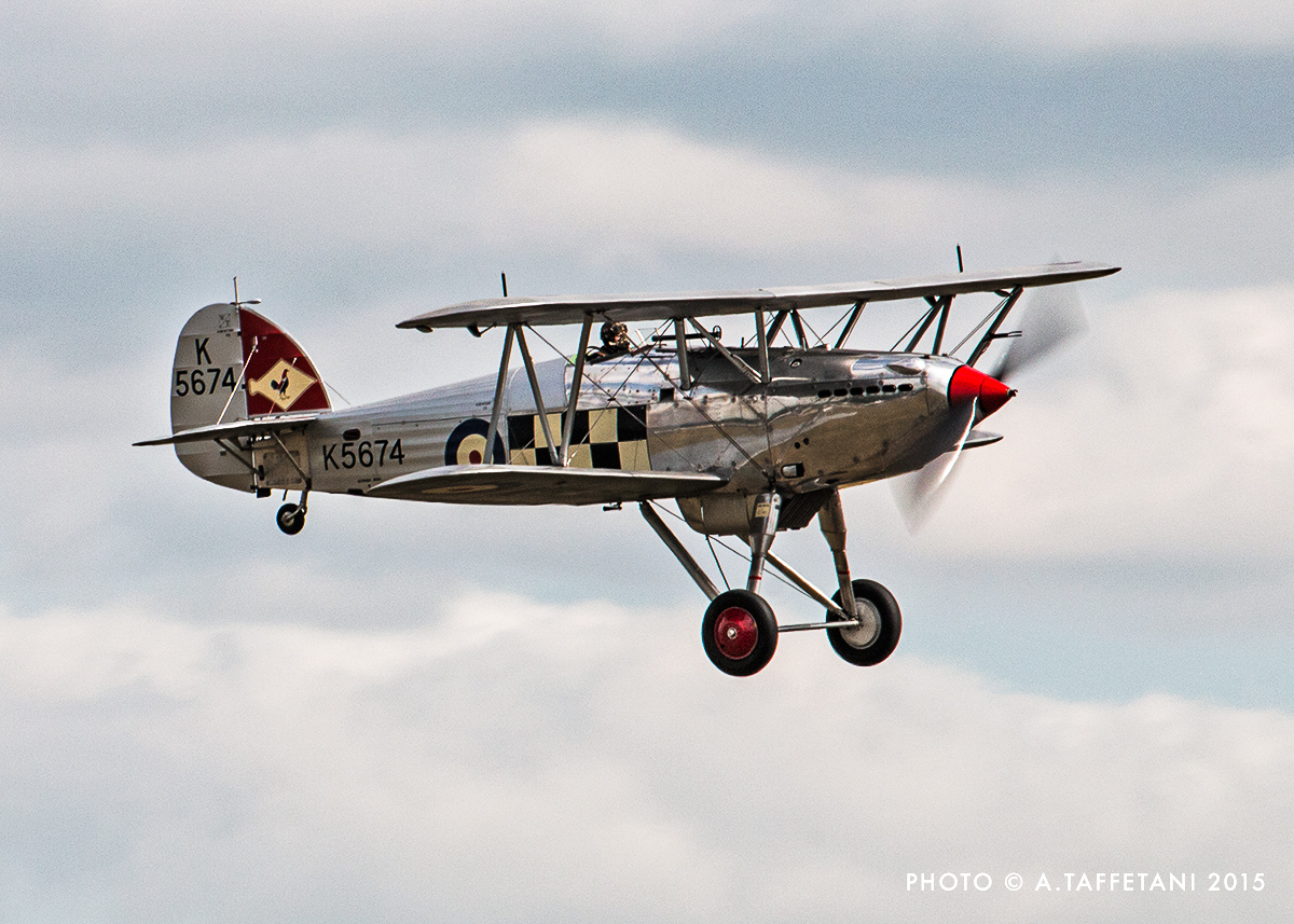 The world's sole surviving Hawker Fury fighter plane, one of a stable of beautiful interwar biplanes produced by Hawkers. Duxford boasted three Hawker biplanes this year... something to be found nowhere else in the world. (photo by Alessandro Taffetani)