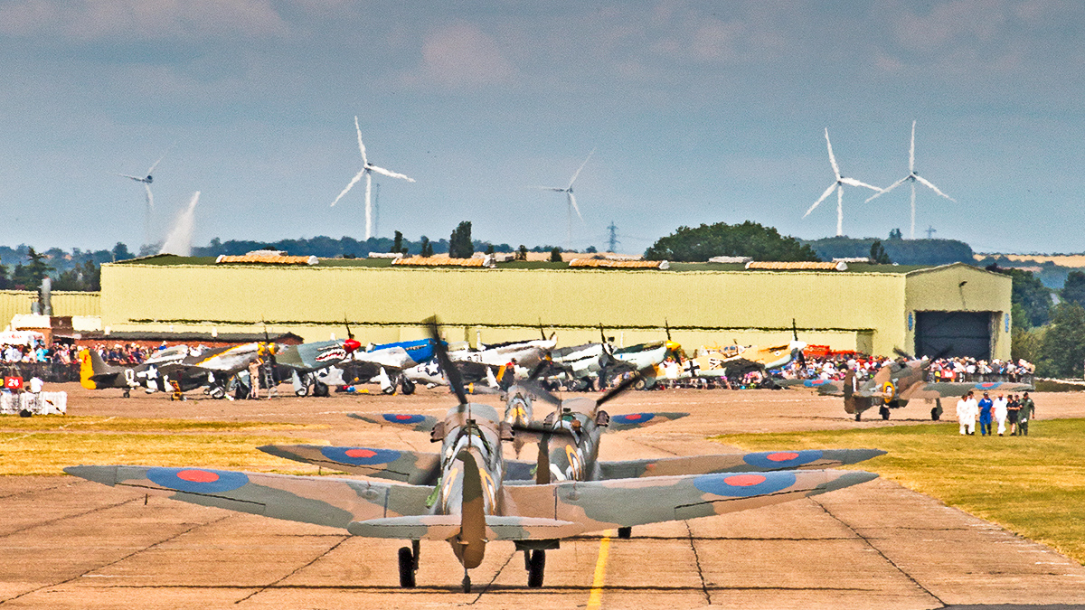 Spitfires taxiing out at Flying Legends... Note the myriad of fighters in the background. (photo by Alessandro Taffetani)