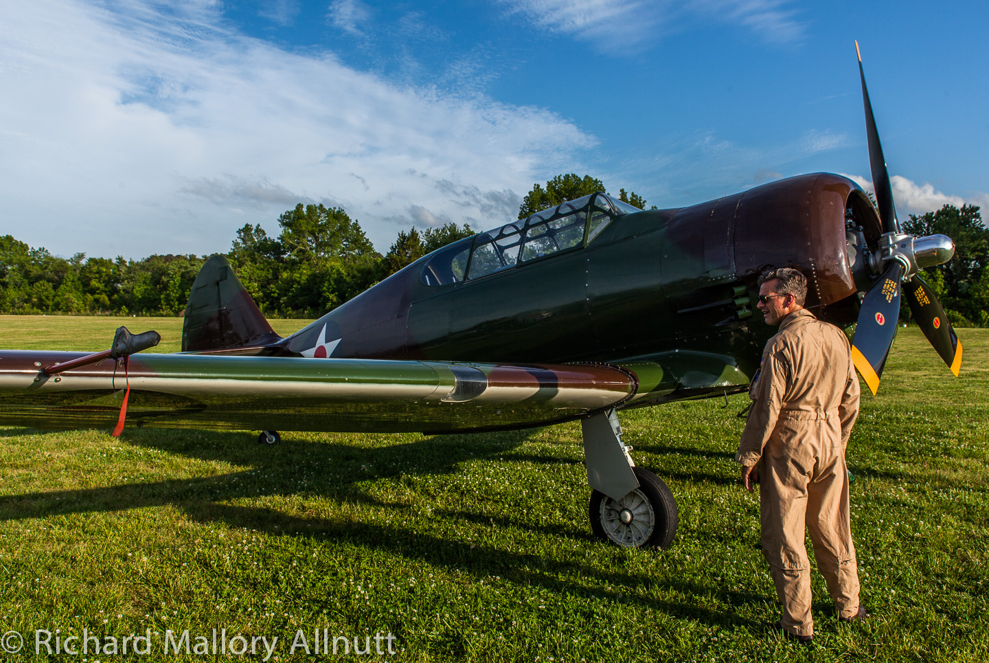 Military Aviation Museum pilot Mike Hogan inspecting the newly arrived P-64 making a low pass at Pungo. (photo by Richard Mallory Allnutt)