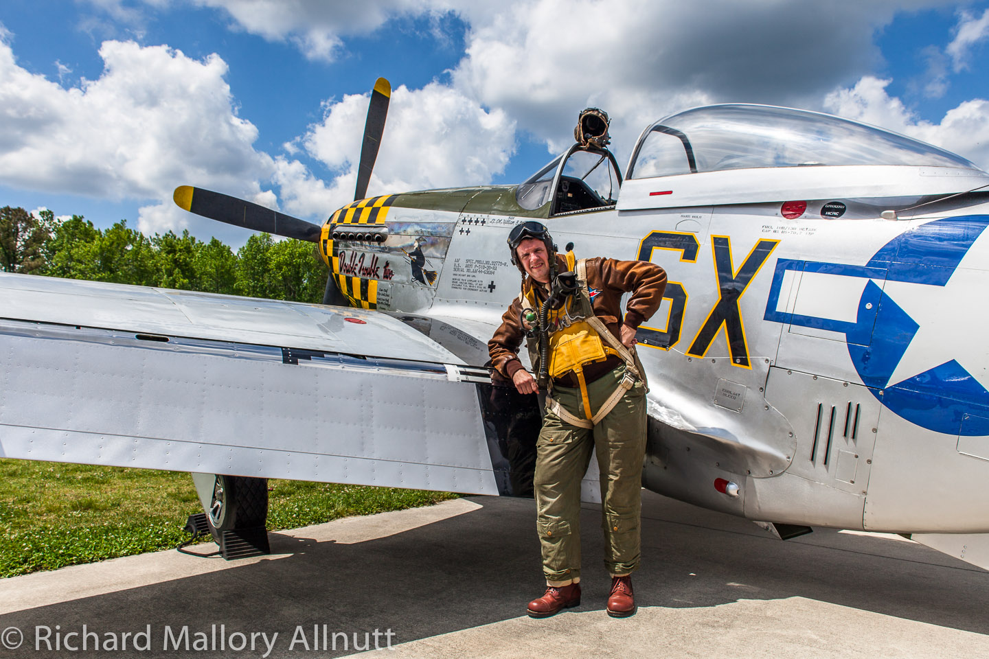 Lynn Ritger dressed as a US Army Air Corps pilot poses beside the museum's P-51D Mustang. (photo by Richard Mallory Allnutt)