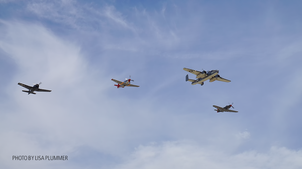 Missing Man formation CAF PBJ in the lead, PSAM P-51right wing, PSAM P63 KingCobra left wing and the CAF F6F Hellcat outer right wing. ( Photo by Lisa Plummer)