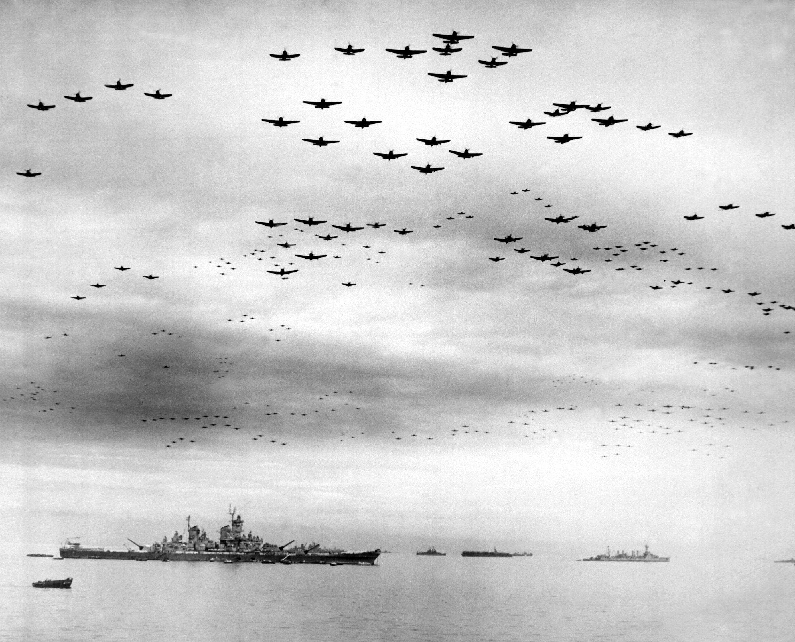 The massed flyover of Allied aircraft over Tokyo Bay during the WWII Japanese Surrender Ceremony aboard the USS Missouri below on September 2nd, 1945. Somewhere amongst the thousand aircraft thundering overhead is TBM-3E Avenger Bu.85632, the aircraft hoping to make the 70th anniversary flyover of the USS Missouri where she is now based, in Pearl Harbor, Hawaii. You can help her on that mission! (photo via Wikipedia)
