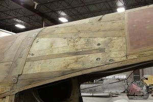 The Mossie's wooden fuselage shows signs of repairs and weather damage. (Image Credit: Calgary Mosquito Society)