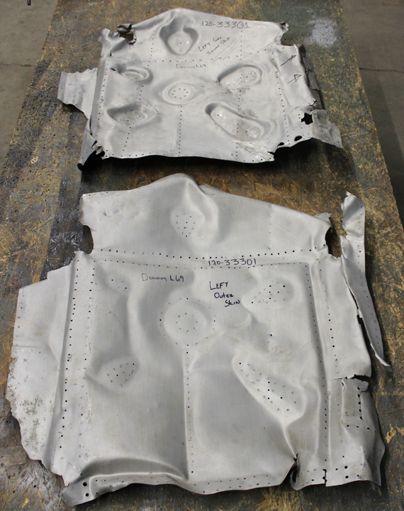 Template parts recovered from the mangled inboard gear doors. (photo via Tom Reilly)