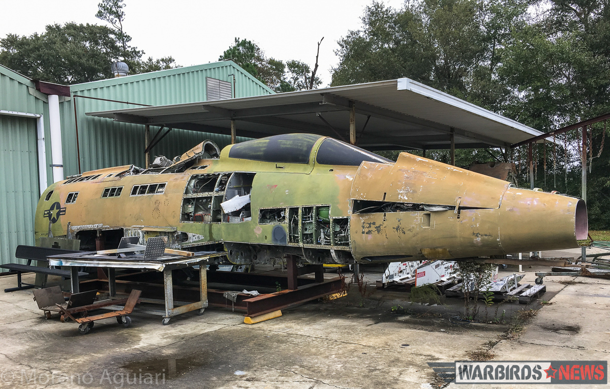 F-100D 56-2298, seen here in pieces outside the restoration shop at the Museum of Aviation, has provided many spare parts for the restoration of 56-2995, including a set of wings. (photo by Moreno Aguiari)