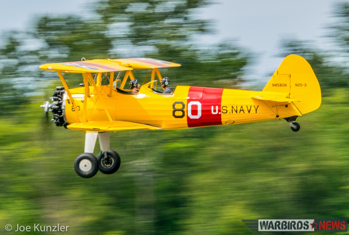 Alex Bock's Stearman on a low fly-by. (photo by Joe Kunzler)