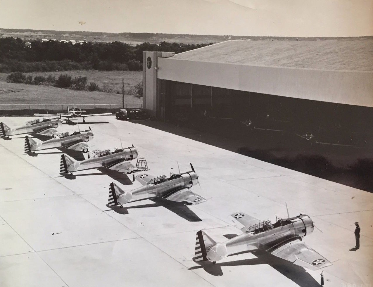 Adjacent to the main Plant building was a storage Hangar for AT-6s awaiting delivery. Texans were amazed to read about the 300 foot wide door which allowed the aircraft to access the ramp. (Image from the CAF Collection)